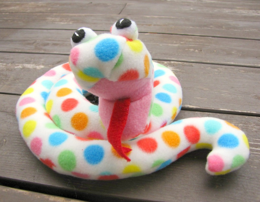 cute snake stuffie artisan in the woods