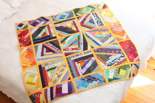 Liberated Log Cabin quilt-as-you-go baby quilt